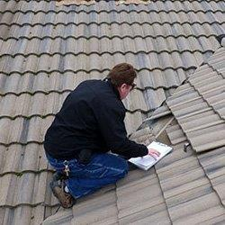 Home inspector inspecting roof
